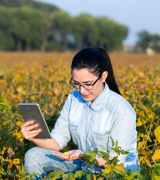 Picture of women working with a tablet in a field